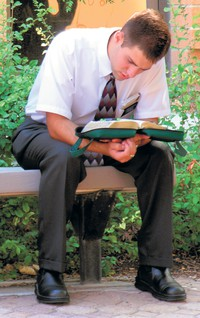 missionary reading scriptures