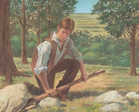 Joseph lifting rock