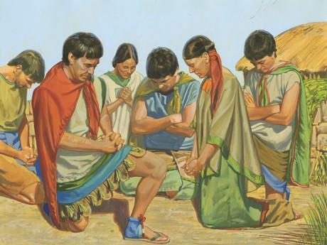 group of men praying