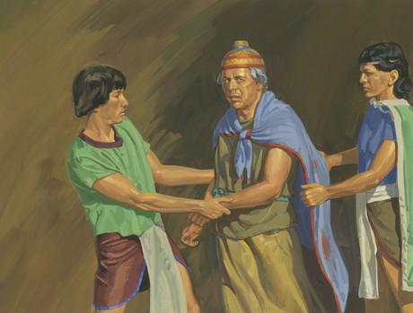 men grabbing Seantum's robe