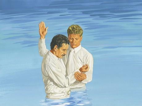 man getting baptized
