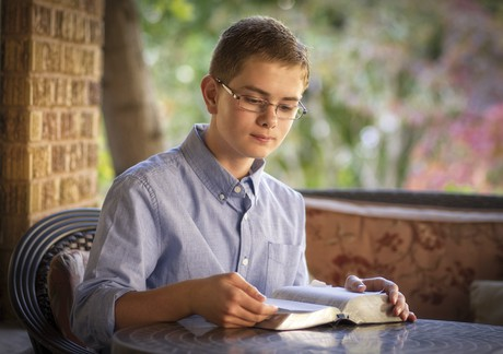 boy reading scriptures