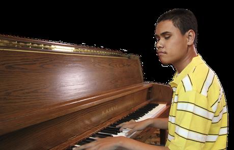 young man at piano