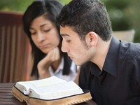 young man and woman reading scriptures