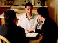 missionaries teaching in kitchen