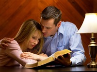 woman and man with scriptures