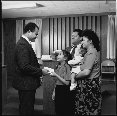 young girl paying tithing