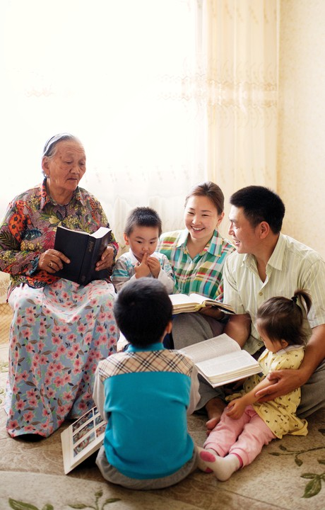 family studying scriptures