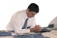 elder missionary praying
