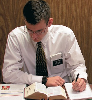 elder missionary studying