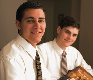 two elder missionaries studying