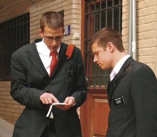 elder missionaries with appointment book