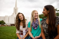 young women in front of temple