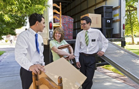 missionaries helping woman move