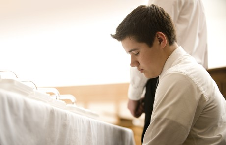 young man blessing sacrament