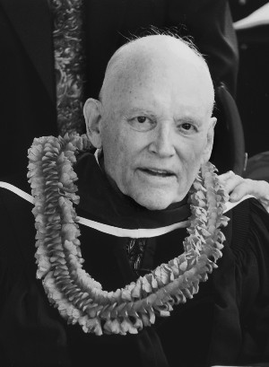 academic gown and lei