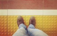 feet next to line