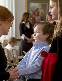 woman greeting a boy