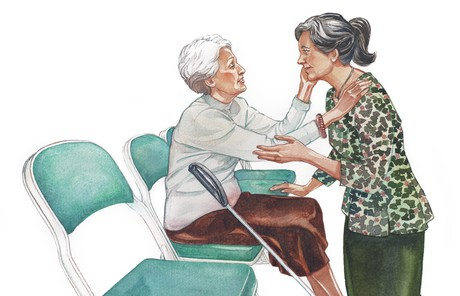 elderly woman talking to other woman