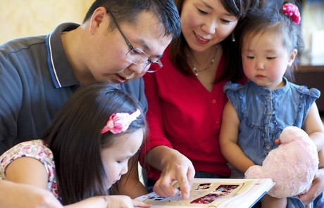 family looking at book