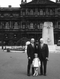 William E. Berrett, John M. Madsen, and child
