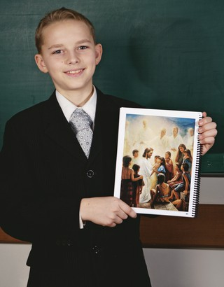 boy holding up picture