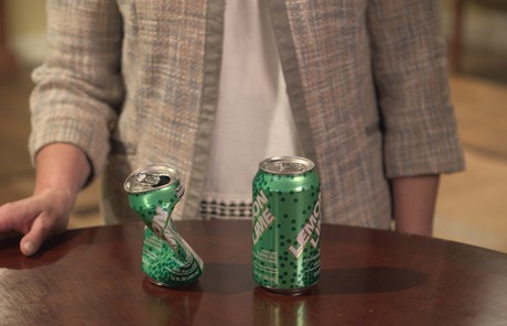 woman with soda cans