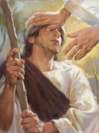 man having hands laid on his head