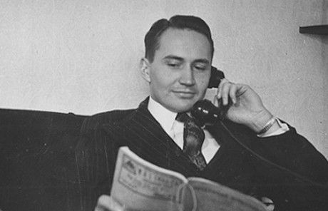 L. Tom Perry talking on phone