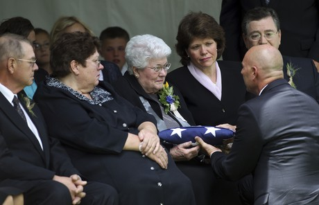 Sister Packer receiving a flag