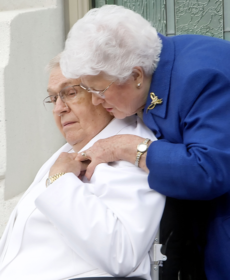 President Packer and his wife holding hands