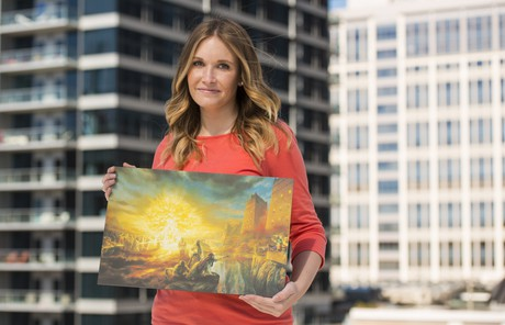 woman holding painting of Lehi's dream