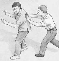 man pushing another man