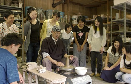 Elder Aoba creating pottery with youth