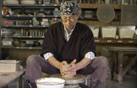 Elder Aoba creating pottery