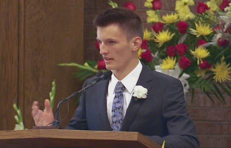 Zane Openshaw speaking at funeral