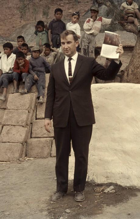 Richard G. Scott holding up Book of Mormon