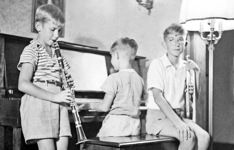 brothers playing musical instruments