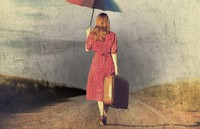 woman walking with umbrella and suitcase