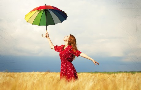 woman with umbrella in field