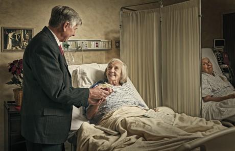 man visiting woman in hospital