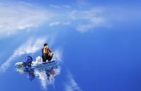 man sitting in boat