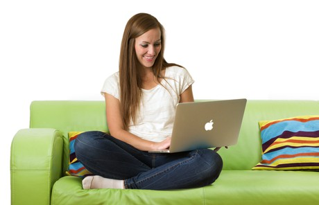 young adult woman with laptop on couch