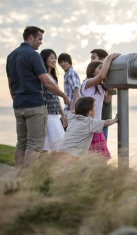 family looking out telescope