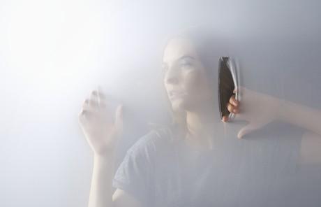 woman behind screen
