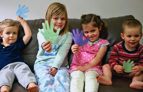Children recorded acts of service on cutout hands