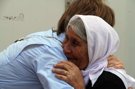 Aid worker embracing a refugee