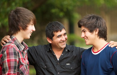 Father with teenage sons