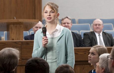 woman bearing testimony in church