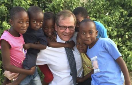 Elder Stevenson with African children